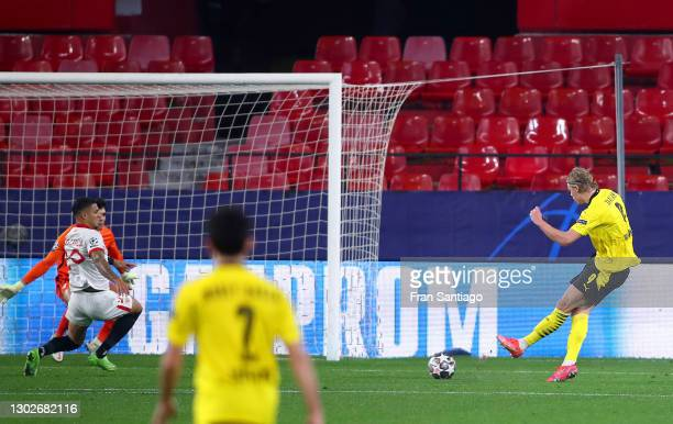 Erling Haaland of Borussia Dortmund scores their side's third goal during the UEFA Champions League Round of 16 match between Sevilla FC and Borussia...