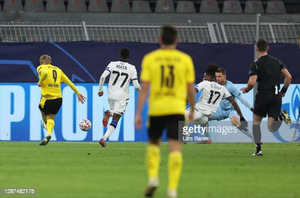 Erling Haaland of Borussia Dortmund scores their team's first goal during the UEFA Champions League Group F stage match between Borussia Dortmund and...