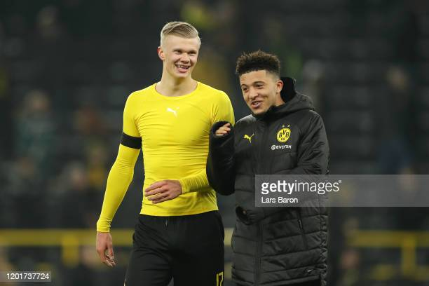 Erling Haaland of Borussia Dortmund speaks with Jadon Sancho of Borussia Dortmund after the Bundesliga match between Borussia Dortmund and 1 FC Koeln...