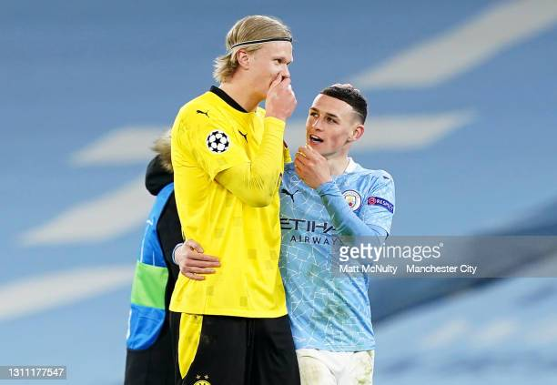 Erling Haaland of Borussia Dortmund talks with Phil Foden of Manchester City at full time during the UEFA Champions League Quarter Final match...