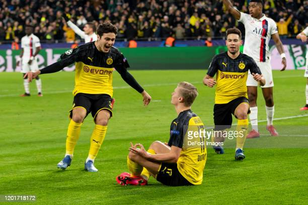 Erling Haaland of Borussia Dortmund with Giovanni Reyna of Borussia Dortmund and Raphael Guerreiro of Borussia Dortmund celebrates after scoring his...