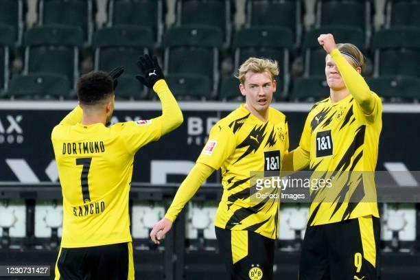 Erling Haaland of Borussia Dortmund with Julian Brandt of Borussia Dortmund and Jadon Sancho of Borussia Dortmund celebrates after scoring his team's...