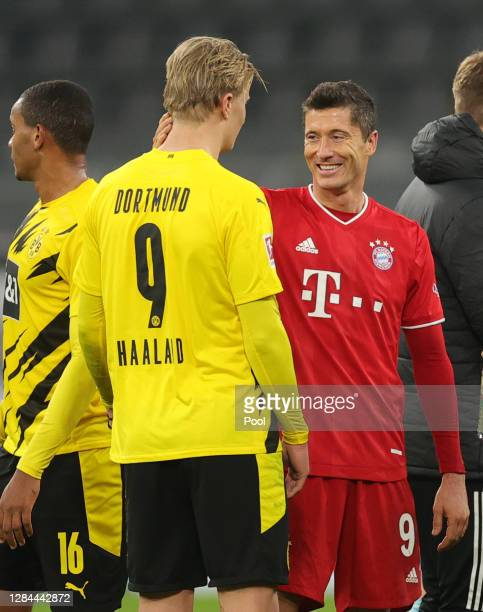 Erling Haaland of Dortmund and Robert Lewandowski of Muenchen chat after the Bundesliga match between Borussia Dortmund and FC Bayern Muenchen at...