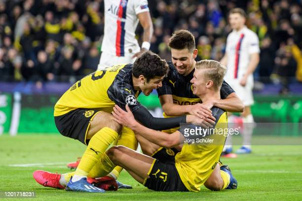 Erling Haaland of Dortmund celebrates after scoring his teams first goal during the UEFA Champions League round of 16 first leg match between...