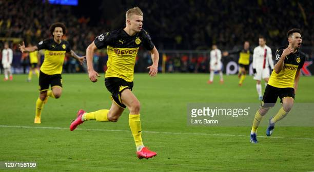 Erling Haaland of Dortmund celebrates after scoring his teams second goal during the UEFA Champions League round of 16 first leg match between...