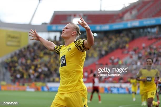 Erling Haaland of Dortmund celebrates scoring his teams fourth goal during the Bundesliga match between Bayer 04 Leverkusen and Borussia Dortmund at...