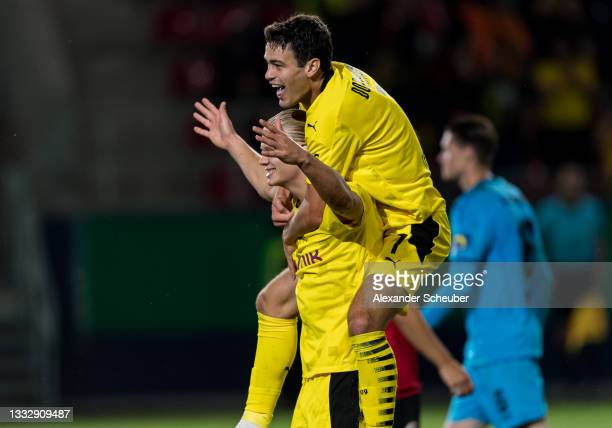 Erling Haaland of Dortmund celebrates the third goal for his team with Giovanni Reyna of Dortmund during the DFB Cup first round match between SV...