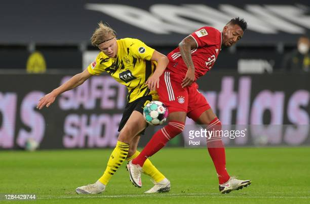 Erling Haaland of Dortmund is challenged by Jerome Boateng of Muenchen during the Bundesliga match between Borussia Dortmund and FC Bayern Muenchen...