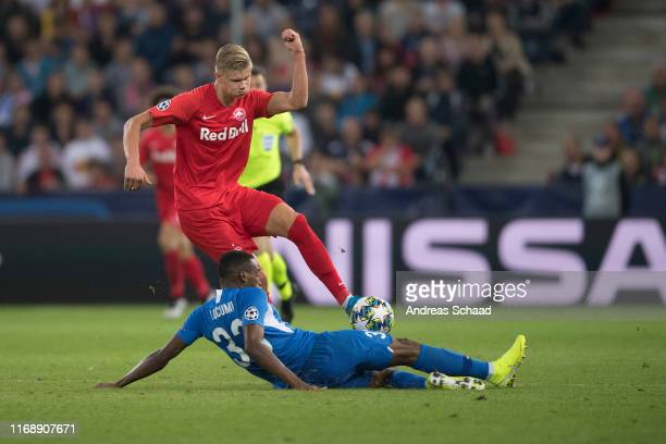 Erling Haaland of FC Salzburg and Jhon Lucumi of KRC Genk during the champions league group E match between FC Salzburg and KRC Genk at Salzburg...