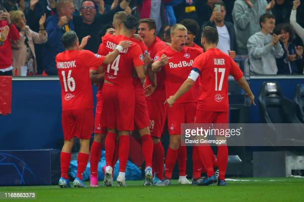 Erling Haaland of Salzburg celebrates with his teammates after scoring the opening goal during the UEFA Champions League match between RB Salzburg...