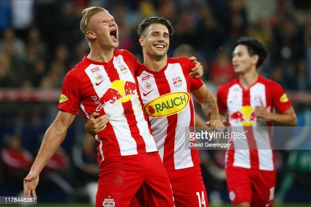 Erling Haaland of Salzburg celebrates with scorer Dominik Szoboszlai of Salzburg after his goal during the tipico Bundesliga match between FC Red...