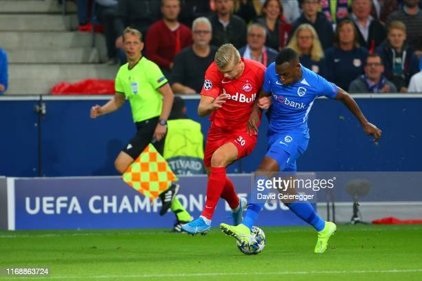 Erling Haaland of Salzburg challenges Jhon Lucumi of Genk during the UEFA Champions League match between RB Salzburg and KRC Genk at Red Bull Arena...