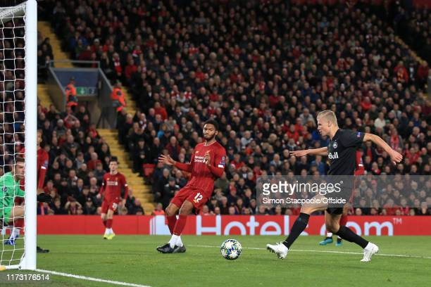 Erling Haaland of Salzburg scores their 3rd goal during the UEFA Champions League group E match between Liverpool FC and RB Salzburg at Anfield on...