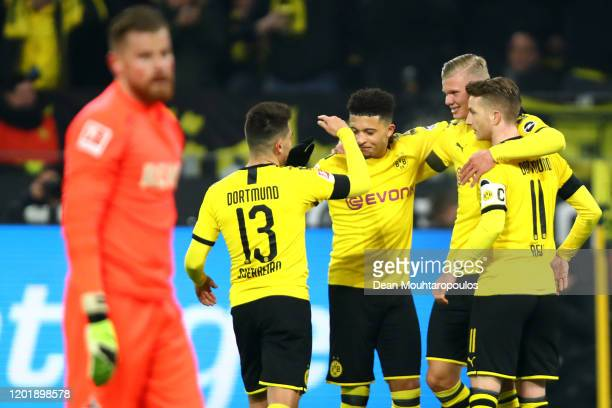 Erling Haland of Borussia Dortmund celebrates scoring his first goal of the game with team mates Raphael Guerreiro Jadon Sancho and Marco Reus during...