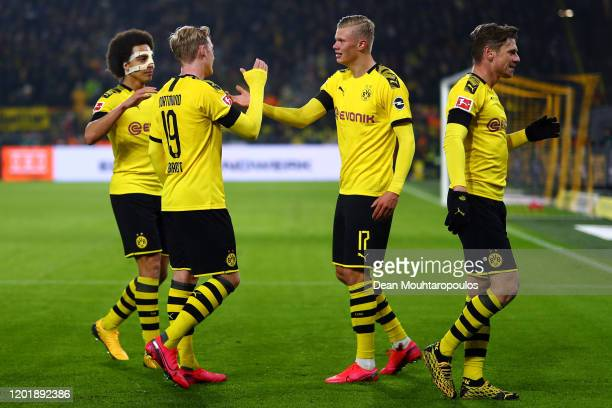 Erling Haland of Borussia Dortmund celebrates scoring his second goal of the game with team mates Julian Brandt Axel Witsel and Lukasz Piszczek...