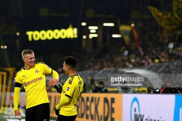 Erling Haland of Borussia Dortmund celebrates scoring his second goal of the game with team mate Jadon Sancho during the Bundesliga match between...