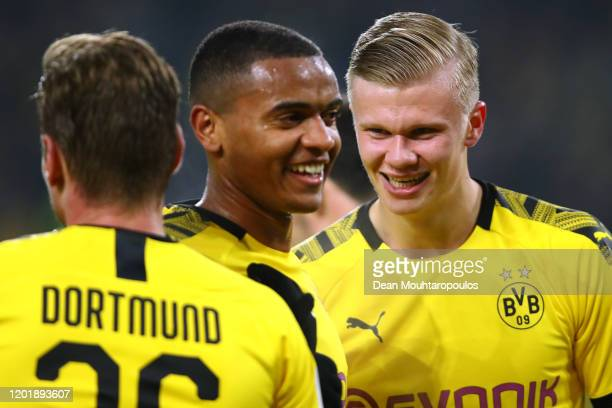Erling Haland of Borussia Dortmund celebrates scoring his second goal of the game with team mates Julian Brandt and Lukasz Piszczek during the...