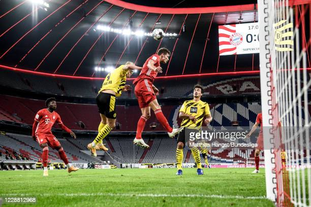 Erling Haland of Borussia Dortmund jumps for a header with Benjamin Pavard of FC Bayern München during the Supercup 2020 match between FC Bayern...