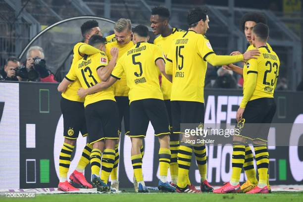 Erling Haland of Dortmund celebrates his team's third goal with team mates during the Bundesliga match between Borussia Dortmund and Eintracht...
