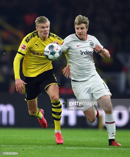 Erling Haland of Dortmund is challenged by Martin Hinteregger of Frankfurt during the Bundesliga match between Borussia Dortmund and Eintracht...