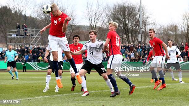Erling Haland of Norway and Luca Hermann of Germany go up for a header during the UEFA Under19 European Championship Qualifier match between Germany...