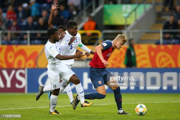 Erling Haland of Norway is tackled by Elison Rivas and Wesly Decas of Honduras during the 2019 FIFA U20 World Cup group C match between Norway and...