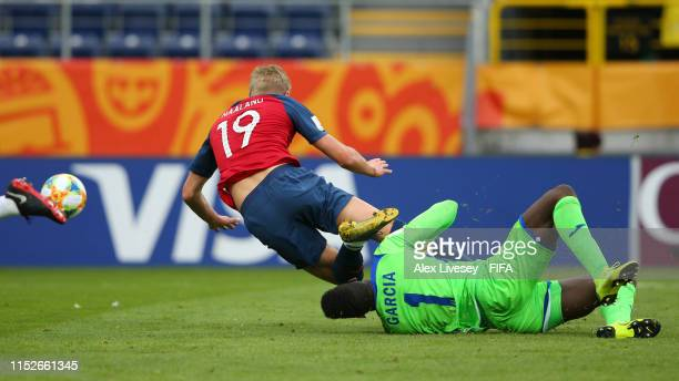 Erling Haland of Norway is tackled by Jose Garcia of Honduras which leads to a penalty for Norway during the 2019 FIFA U20 World Cup group C match...