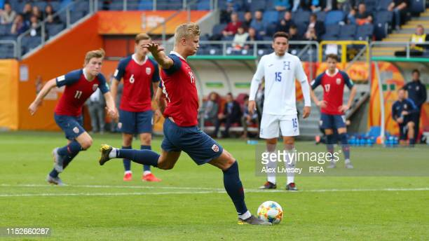 Erling Haland of Norway scores his team's fourth goal from the penalty spot during the 2019 FIFA U20 World Cup group C match between Norway and...