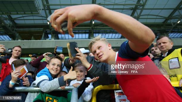 Erling Haland of Norway takes pictures with fans following his team's victory in the 2019 FIFA U20 World Cup group C match between Norway and...