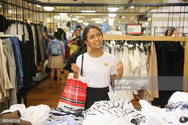 Erlyan Pan from Sydney checks out merchandise inside the Myer city store during the Boxing Day sales on December 26 2015 in Sydney Australia Boxing...