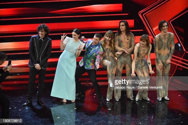 Ermal Meta, Fedez, Francesca Michielin and Maneskin are seen posing for a photo on stage during the 71th Sanremo Music Festival 2021 at Teatro...