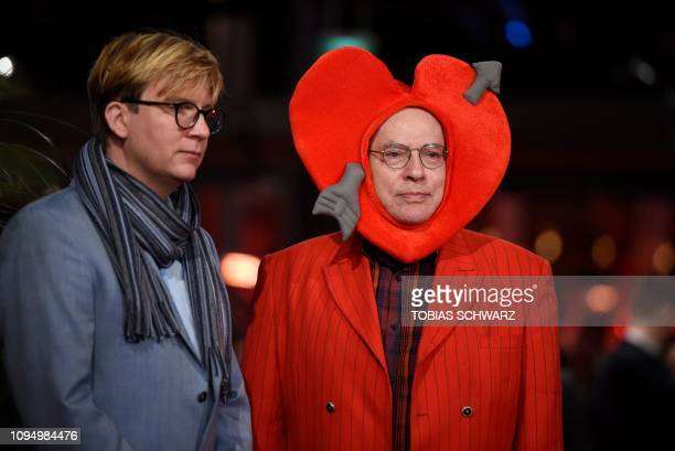 erman director Rosa von Praunheim and his companion Oliver Sechting pose for photograhers as they arrive for the opening ceremony of the 69th...