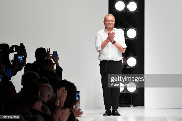 Ermanno Scervino acknowledges the applause of the audience at the Ermanno Scervino show during Milan Fashion Week Spring/Summer 2018 on September 23...