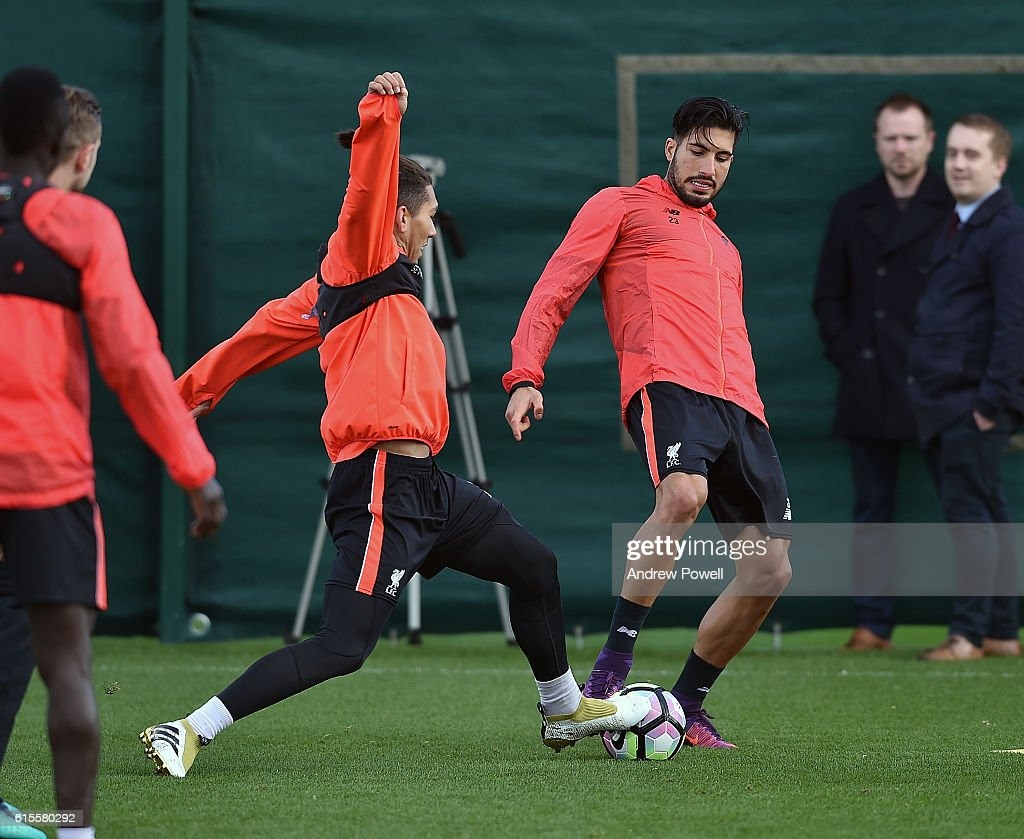 Erme Can and Roberto Firmino of Liverpool during a training session at Melwood Training Ground on October 19, 2016 in Liverpool, England.
