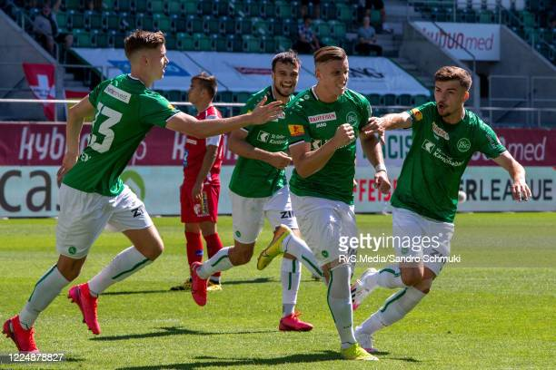 Ermedin Demirovic of FC St. Gallen 1879 celebrates with his teammates after scoring a goal during the Swiss Raiffeisen Super League match between FC...