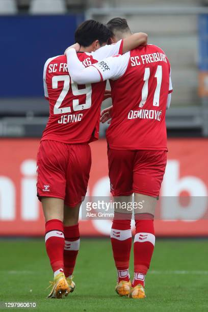 Ermedin Demirovic of SC Freiburg celebrates with teammate Jeong Woo-Yeong after scoring their team's first goal during the Bundesliga match between...