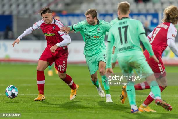 Ermedin Demirovic of SC Freiburg, Christoph Kramer of Borussia Moenchengladbach, Oscar Wendt of Borussia Moenchengladbach and Lucas Hoeler of SC...