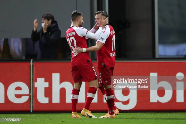 Ermedin Demirovic of Sport-Club Freiburg celebrates with team mate Vincenzo Grifo after scoring their sides second goal during the Bundesliga match...