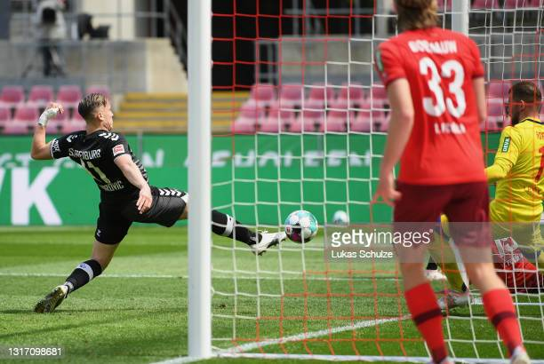 Ermedin Demirovic of Sport-Club Freiburg scores their sides second goal during the Bundesliga match between 1. FC Koeln and Sport-Club Freiburg at...