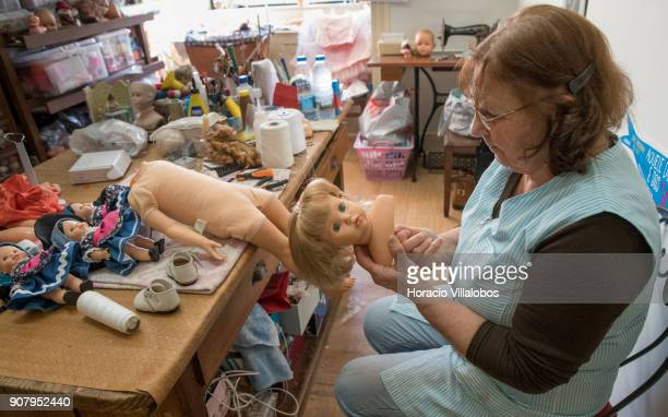 Ermelinda Francisco at work on one of the dolls at 'Hospital de Bonecas' on January 18 2018 in Lisbon Portugal Started in 1830 by Dona Carlota an old...