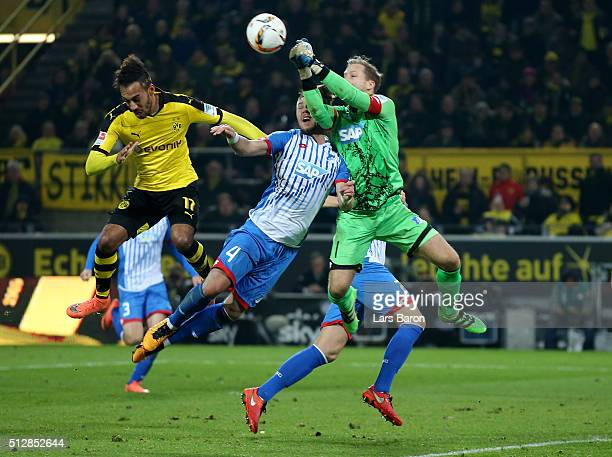 Ermin Bicakcic of 1899 Hoffenheim collides with goalkeeper Oliver Baumann of 1899 Hoffenheim challenged by PierreEmerick Aubameyang of Borussia...
