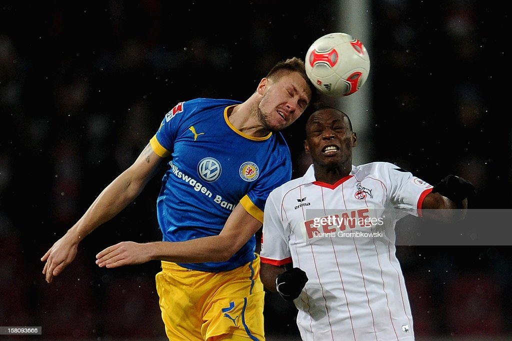Ermin Bicakcic of Braunschweig and Anthony Ujah of Cologne go up for a header during the Bundesliga match between 1. FC Koeln and Eintracht Braunschweig at RheinEnergieStadion on December 10, 2012 in Cologne, Germany.
