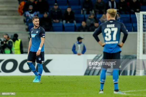 Ermin Bicakcic of Hoffenheim Robin Hack of Hoffenheim looks dejected after the UEFA Europa League group C match between 1899 Hoffenheim and PFC...