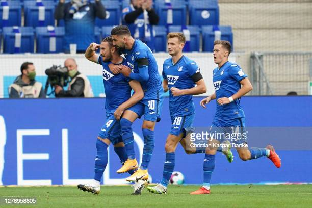 Ermin Bicakcic of TSG 1899 Hoffenheim celebrates after scoring his sides first goal during the Bundesliga match between TSG Hoffenheim and FC Bayern...