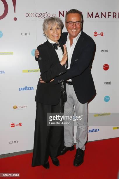 Erminia Ferrari and Massimo Ghini attend the Homage To Nino Manfredi photocall at Auditorium della Conciliazione on June 7 2014 in Rome Italy