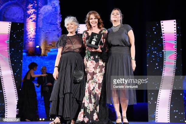 Erminia Ferrari Manfredi Claudia Gerini and a guest are awarded during the Nastri D'Argento Award Ceremony on June 30 2018 in Taormina Italy