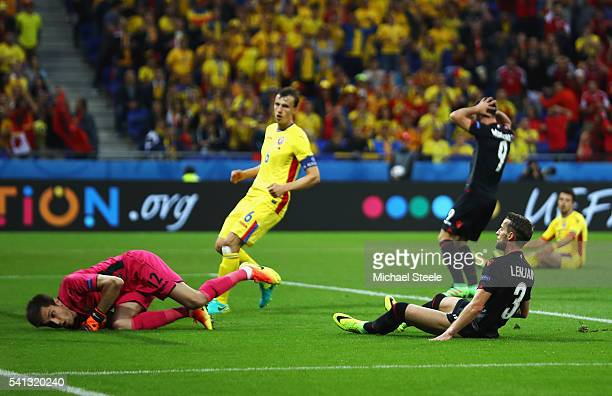 Ermir Lenjani of Albania reacts after missing a chance during the UEFA EURO 2016 Group A match between Romania and Albania at Stade des Lumieres on...
