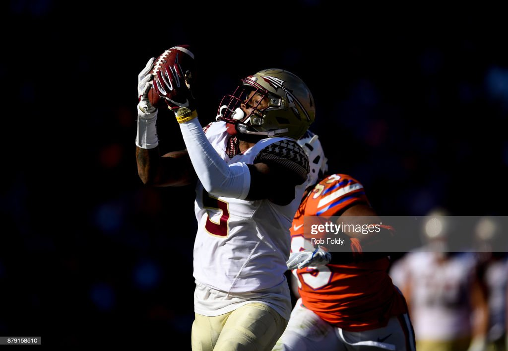 Ermon Lane #7 of the Florida State Seminoles hauls in a 39-yard reception during the second half of the game against the Florida Gators at Ben Hill Griffin Stadium on November 25, 2017 in Gainesville, Florida.