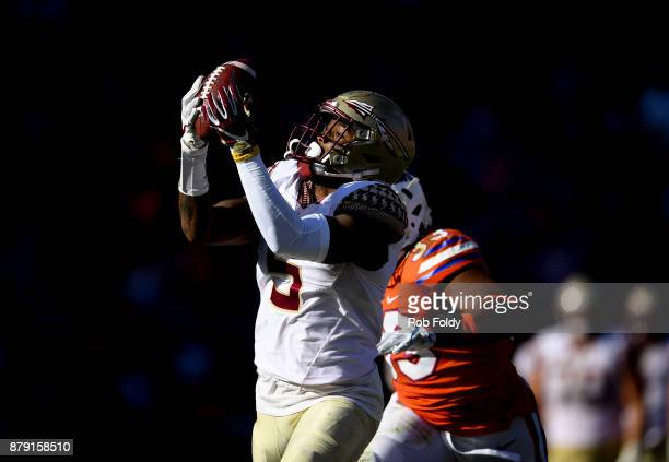 Ermon Lane of the Florida State Seminoles hauls in a 39yard reception during the second half of the game against the Florida Gators at Ben Hill...