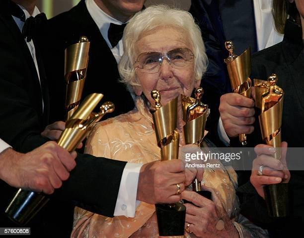 Erna Baumbauer poses with awards for her lifetime achievement at the German Film Awards at the Palais am Funkturm May 12 2006 in Berlin Germany